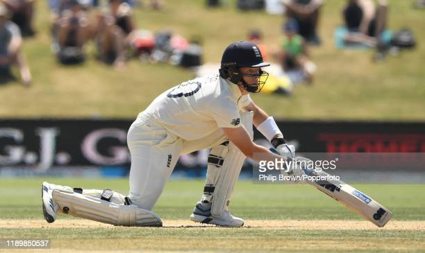 Ollie Pope of England looks on as he is caught by Mitchell Santner during day five of the first Test match between New Zealand and England at Bay...