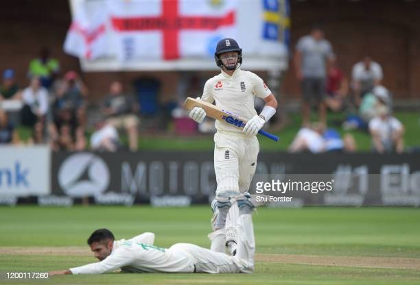 Ollie Pope of England picks up runs past a stranded Keshav Maharaj during Day Two of the Third Test between South Africa and England at St George's...