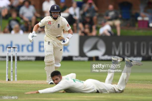 Ollie Pope of England runs past Keshav Maharaj of South Africa during Day Two of the Third Test between England and South Africa on January 17, 2020...