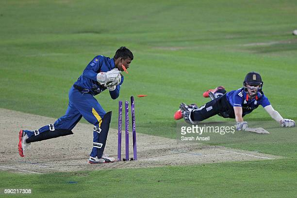 Ollie Pope of England U19 is run out for 87 runs as Sri Lanka U19 wicket keeper Navindu Vithanage whips off the bails during the Royal London OneDay...