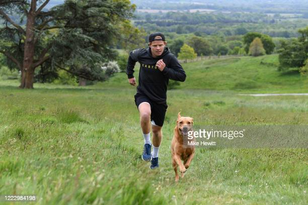 Ollie Pope of Surrey and England goes for a run with Dexter during the coronavirus pandemic on May 05, 2020 in Haslemere, England.