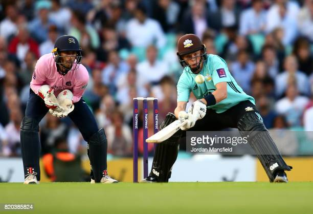 Ollie Pope of Surrey attemps to hit past John Simpson of Middlesex takes the bails off during the NatWest T20 Blast Surrey and Middlesex at The Kia...