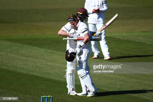 Ollie Pope of Surrey celebrates his 200 with Jamie Smith of Surrey during day three of the LV= Insurance County Championship match between Surrey and...