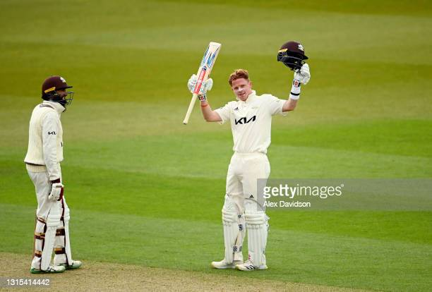 Ollie Pope of Surrey celebrates reaching his century alongside Hashim Amla during Day Two of the LV= Insurance County Championship match between...