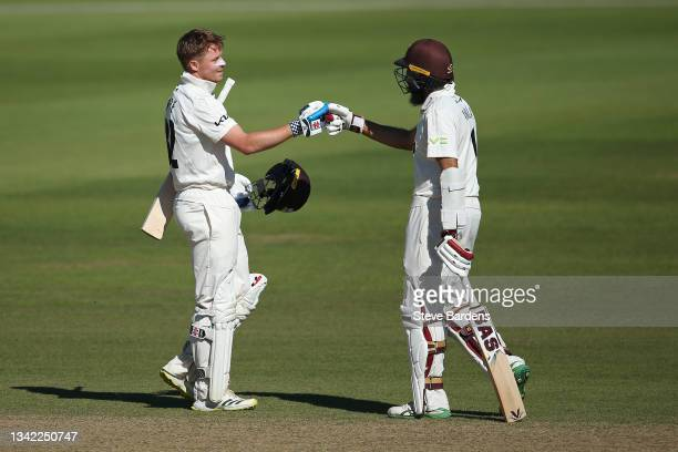 Ollie Pope of Surrey celebrates reaching his double century with Hashim Amla on day four during the LV= Insurance County Championship match between...