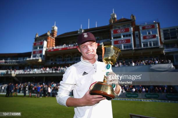 Ollie Pope of Surrey celebrates with the Specsavers County Championship Division One Cup during Day Four of the Specsavers County Championship...
