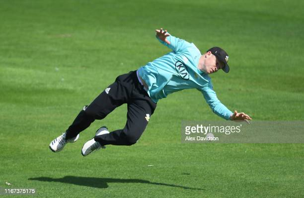 Ollie Pope of Surrey drops Colin Ingram of Glamorgan during the Vitality Blast match between Glamorgan and Surrey at Sophia Gardens on August 11,...