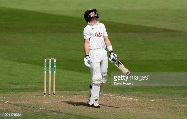 Ollie Pope of Surrey looks dejected after edging the ball to wicket keeper Tom Moores during the Specsavers County Championship division one match...