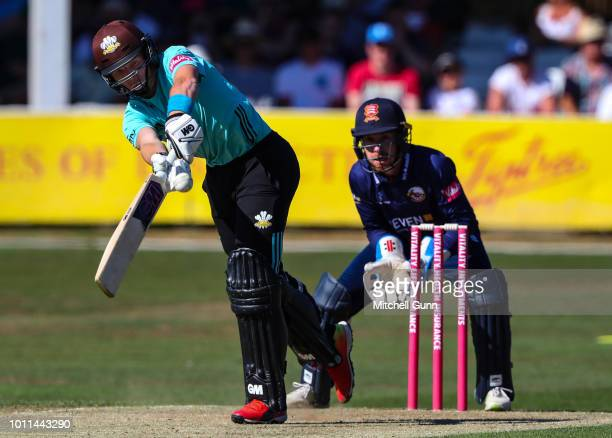 Ollie Pope of Surrey plays a shot as Adam Wheater of Essex looks on during the Vitality Blast T20 match between Essex Eagles and Surrey at The Cloud...