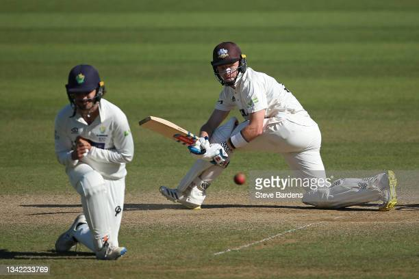 Ollie Pope of Surrey plays a shot past Kiran Carlson of Glamorgan on day four during the LV= Insurance County Championship match between Surrey and...