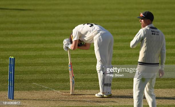 Ollie Pope of Surrey reacts after being dismissed during day two of the LV= Insurance County Championship match between Middlesex and Surrey at...