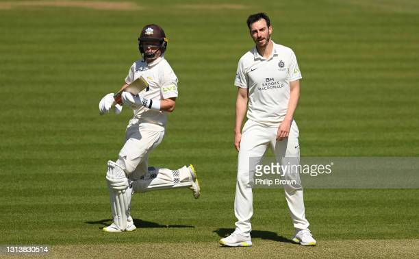 Ollie Pope of Surrey runs past Toby Roland-Jones of Middlesex during day one of the LV= Insurance County Championship match between Middlesex and...
