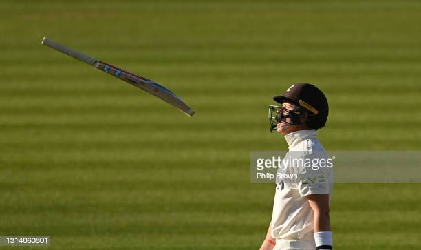 Ollie Pope of Surrey throws his bat as he leaves the field after being dismissed during day two of the LV= Insurance County Championship match...