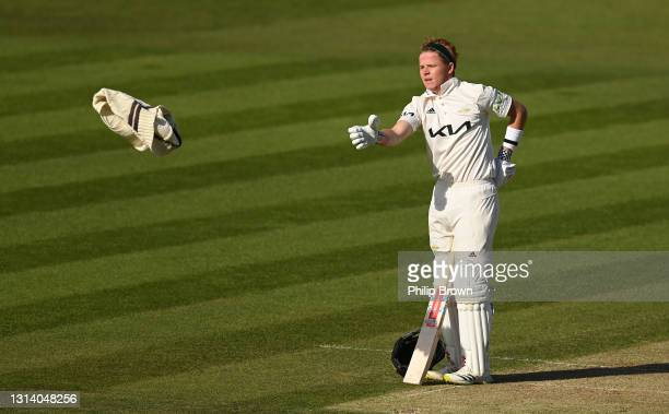 Ollie Pope of Surrey throws his jumper during day two of the LV= Insurance County Championship match between Middlesex and Surrey at Lord's Cricket...