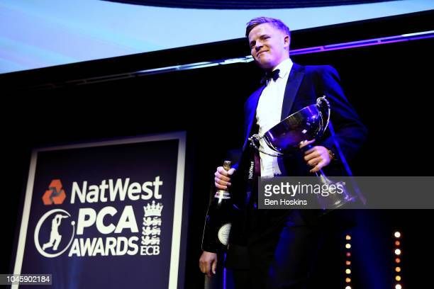 Ollie Pope of Surrey walks off stage after collecting the award for the NatWest PCA Young Player award during the NatWest PCA Awards at The...