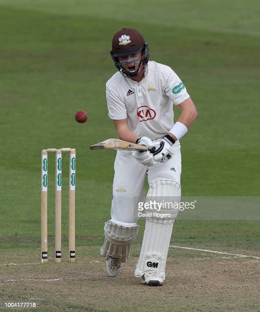 Ollie Pope of Surrey watches the ball during the Specsavers County Championship division one match between Nottinghamshire and Surrey at Trent Bridge...