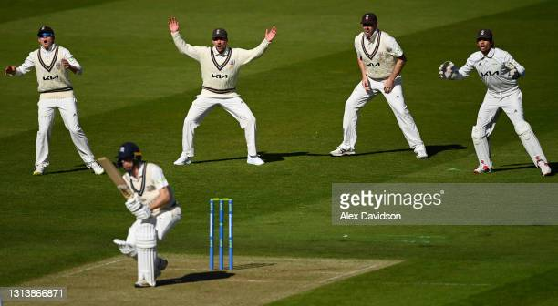 Ollie Pope, Rory Burns, Rikki Clarke and Ben Foakes of Surrey react during Day One of the LV=Insurance County Championship match between Middlesex...