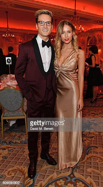 Ollie Proudlock and Emma Connolly attend a drinks reception during the British Heart Foundation Roll Out The Red Ball at The Savoy Hotel on February...