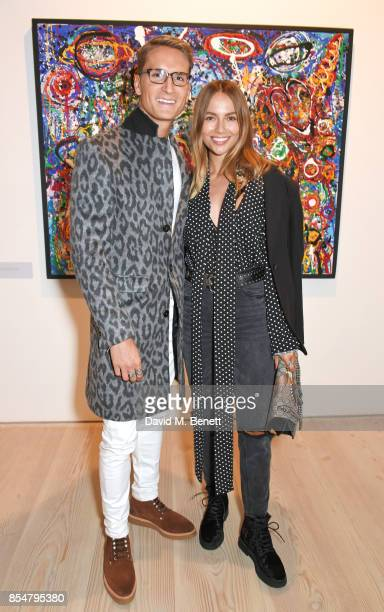 Ollie Proudlock and Emma Louise Connolly attend the private view and launch of Sacha Jafri's 18 year retrospective global tour 'Universal...