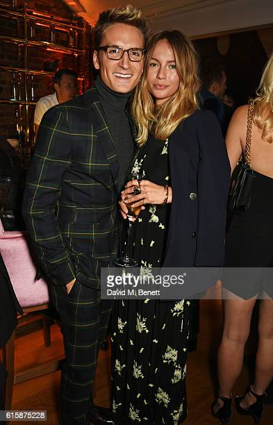 Ollie Proudlock and Emma Louise Connolly attend the Tatler Little Black Book party with Polo Ralph Lauren at Restaurant Ours on October 20 2016 in...