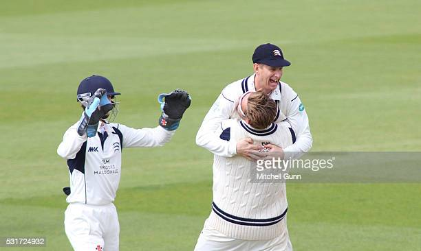 Ollie Rayner and Adam Voges of Middlesex celebrate the wicket of Kumar Sangakara of Surrey during the Specsavers County Championship Division One...