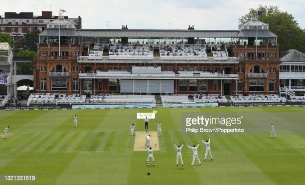 Ollie Robinson of England celebrates after dismissing Ross Taylor of New Zealand lbw during day 1 of the First LV= Insurance Test match between...