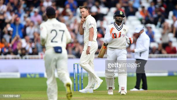 Ollie Robinson of England celebrates after he gets Ravindra Jadeja of India out during day three of the First Test Match between England and India at...