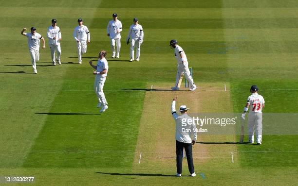 Ollie Robinson of Sussex celebrates taking the wicket of Andy Balbirnie of Glamorgan during day one of the LV= County Championship match between...