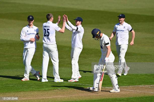 Ollie Robinson of Sussex celebrates with his team mates after taking the wicket of Nick Selman of Glamorgan during day one of the LV= County...