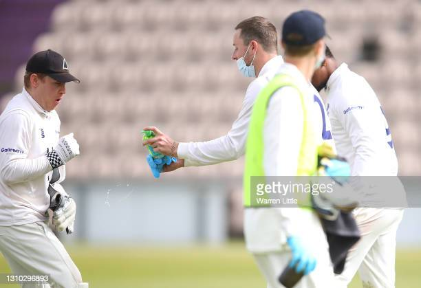 Ollie Robinson of Sussex squirts his team mate and keeper Ben Brown with alcoholic gel in the drinks break during a pre-season warm up match between...