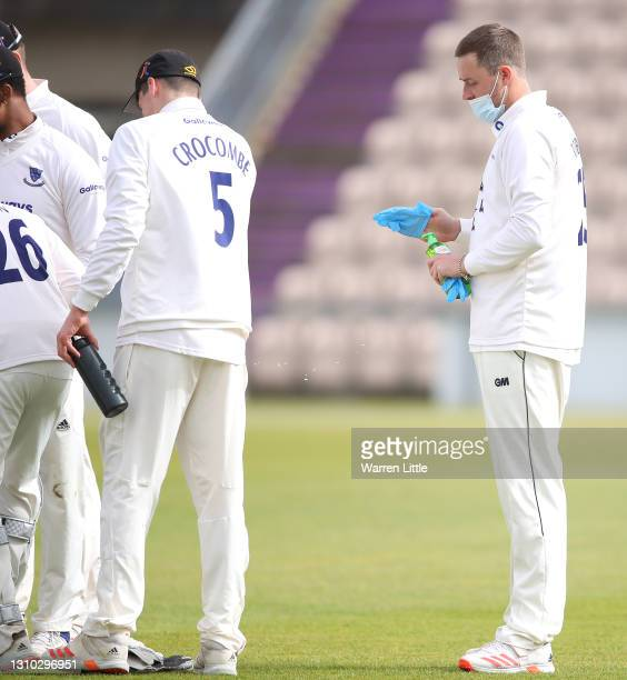 Ollie Robinson of Sussex squirts his team mates with alcoholic gel in the drinks break during a pre-season warm up match between Sussex and Hampshire...