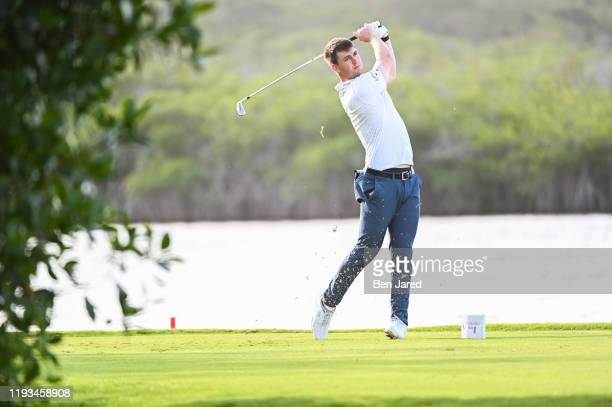 Ollie Schniederjans hits a shot on the fourth tee during the first round of the Korn Ferry Tour's The Bahamas Great Exuma Classic at Sandals Emerald...