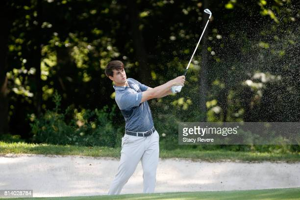 Ollie Schniederjans hits his second shot from a fairway bunker on the sixth hole during the first round of the John Deere Classic at TPC Deere Run on...