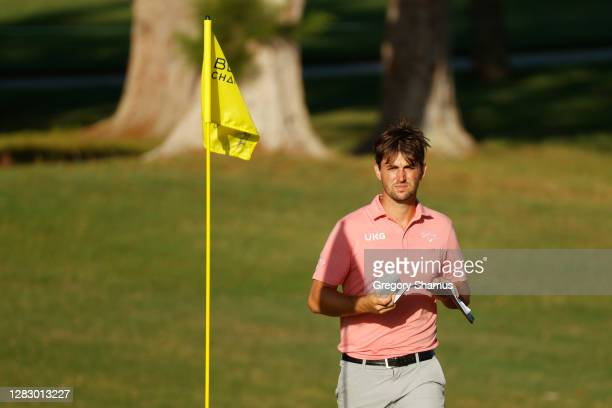 Ollie Schniederjans of the United States checks his yardage book on the fifth green during the second round of the Bermuda Championship at Port Royal...