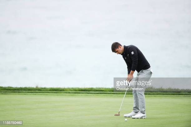 Ollie Schniederjans of the United States hits a putt on the tenth green during the first round of the 2019 U.S. Open at Pebble Beach Golf Links on...