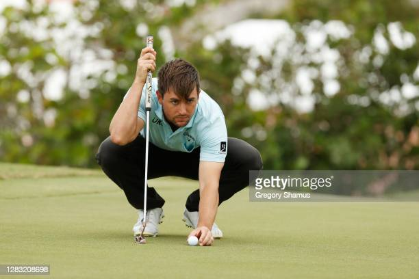 Ollie Schniederjans of the United States lines up a putt 8during the third round of the Bermuda Championship at Port Royal Golf Course on October 31,...