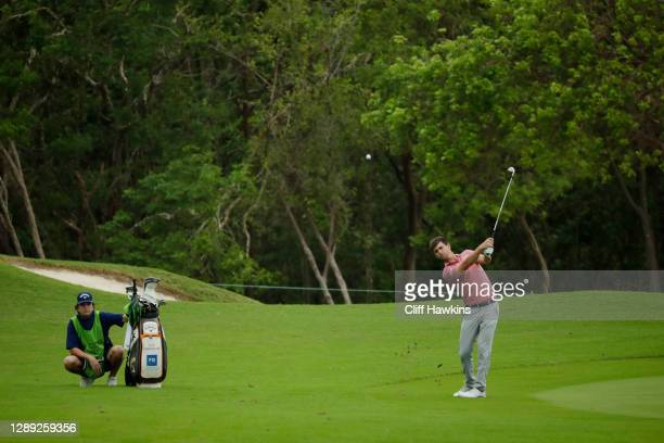 Ollie Schniederjans of the United States plays a shot on the ninth hole during the first round of the Mayakoba Golf Classic at El Camaleón Golf Club...