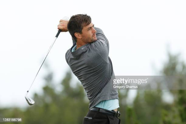 Ollie Schniederjans of the United States plays his shot from the first tee during the third round of the Bermuda Championship at Port Royal Golf...