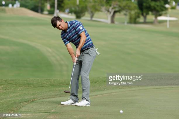 Ollie Schniederjans of the United States putts on the sixth green during the final round of the Bermuda Championship at Port Royal Golf Course on...