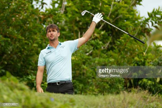 Ollie Schniederjans of the United States reacts to his shot from the eighth tee during the third round of the Bermuda Championship at Port Royal Golf...