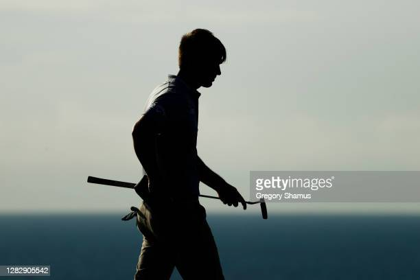Ollie Schniederjans of the United States walks on the eighth green during the first round of the Bermuda Championship at Port Royal Golf Course on...