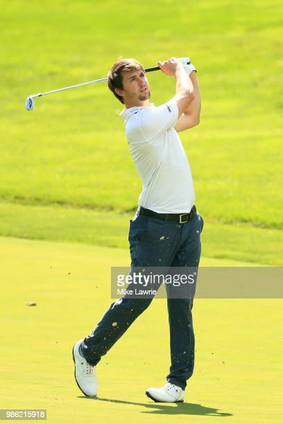 Ollie Schniederjans plays a shot on the 15th fairway during the first round of the Quicken Loans National at TPC Potomac on June 28, 2018 in Potomac,...