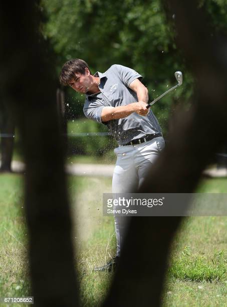 Ollie Schniederjans plays his shot out of the rough on the 18th hole during the second round of the Valero Texas Open at TPC San Antonio AT&T Oaks...