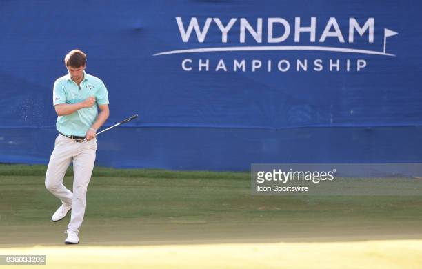 Ollie Schniederjans reacts to making a long birdie putt on the 17th hole during the final round of the Wyndham Championship on August 20 2017 at...