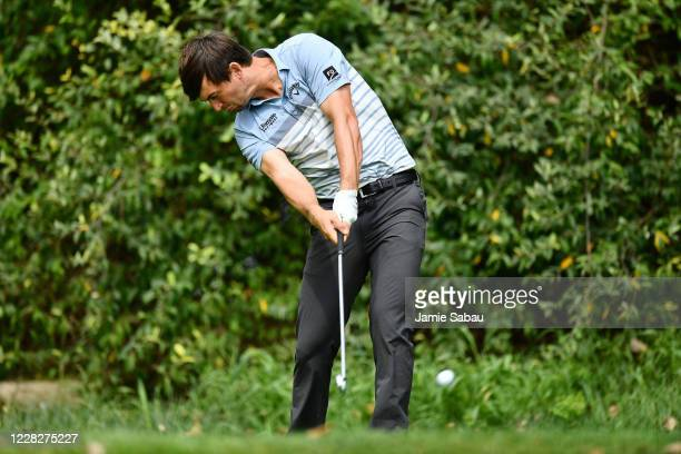 Ollie Schniederjans tees off from the second tee box during the final round of the Korn Ferry Tour Championship at Victoria National Golf Club on...