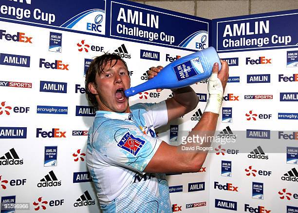 Ollie Smith of Montpellier poses with the Amlin Man of the Match champagne after the Amlin Challenge Cup match between Worcester Warriors and...