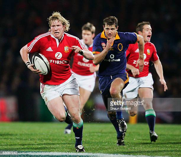Ollie Smith of the Lions breaks forward during the match between British and Irish Lions and Otago at Carisbrook on June 18, 2005 in Dunedin, New...