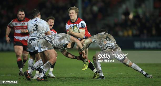 Ollie Thorley of Gloucester breaks the Ospreys line during the AngloWelsh Cup match between Gloucester Rugby and Ospreys at Kingsholm Stadium on...