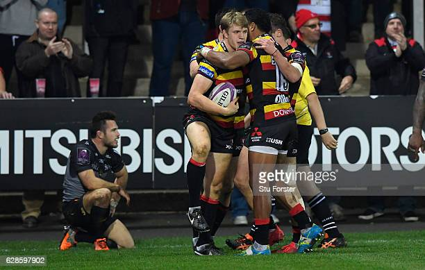 Ollie Thorley of Gloucester celebrates with team mates after scoring the third Gloucester try during the European Rugby Challenge Cup match between...