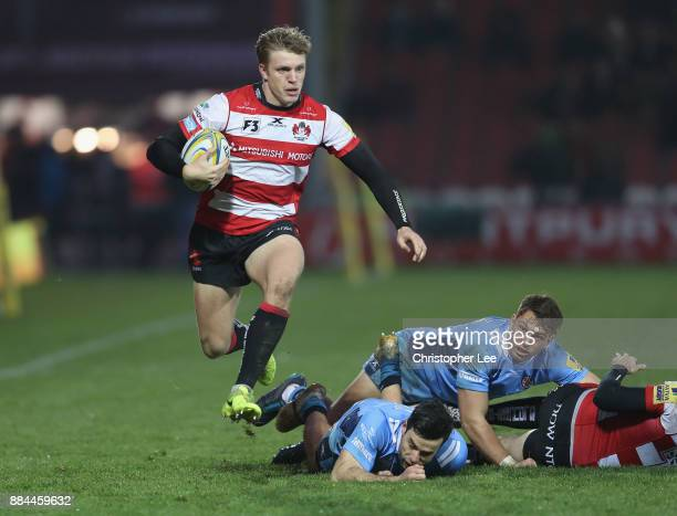 Ollie Thorley of Gloucester gets away from the Irish defence during the Aviva Premiership match between Gloucester Rugby and London Irish at...